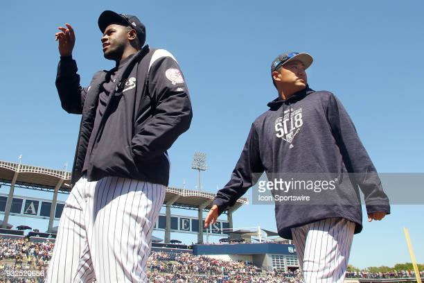 Luis Severino and Masahiro Tanaka of the Yankees step into the dugout before the game between the Pittsburgh Pirates and the New York Yankees on...