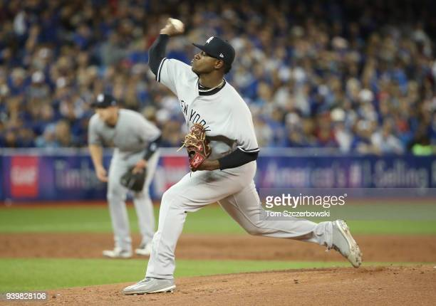 Luis Severino of the New York Yankees delivers his first pitch of the season in the first inning on Opening Day during MLB game action against the...