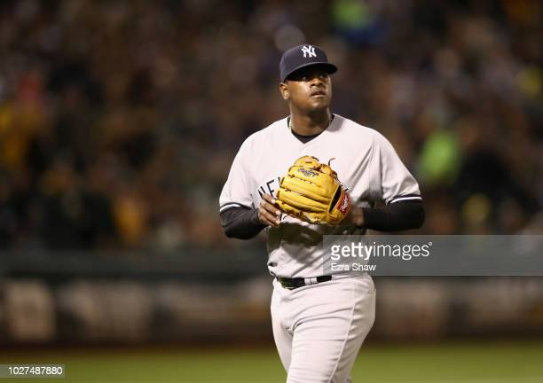 Luis Severino of the New York Yankees is taken out of the game in the third inning against the Oakland Athletics at Oakland Alameda Coliseum on...