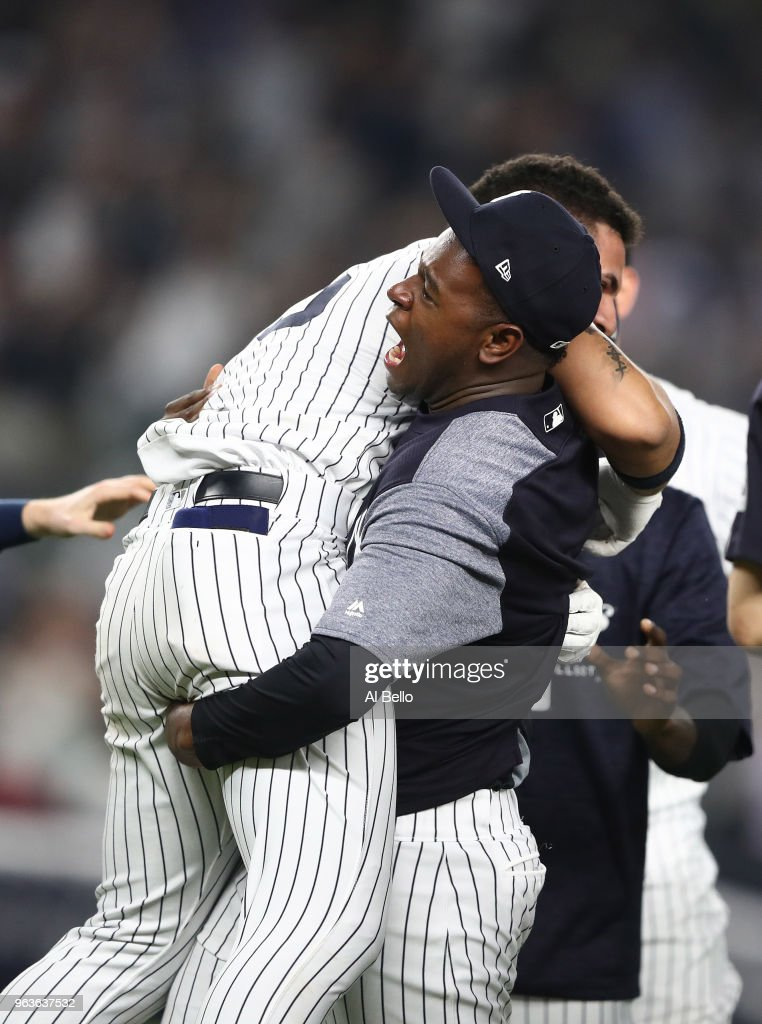 Luis Severino #40 of the New York Yankees lifts Gleyber Torres #25 in celebration after he hit the game winning RBI single in the tenth inning against the Houston Astros at Yankee Stadium on May 29, 2018 in New York City.