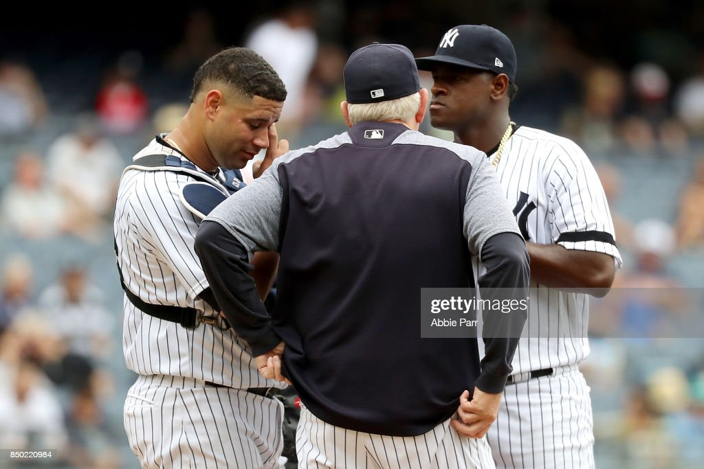 Luis Severino #40 of the New York Yankees meets with Gary Sanchez #24 of the New York Yankees and Pitching Coach Larry Rothschild after giving up three runs in the third inning against Minnesota Twins on September 20, 2017 at Yankee Stadium in the Bronx borough of New York City.