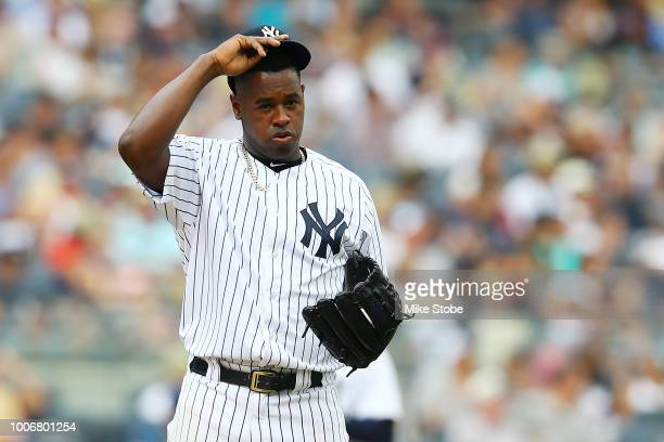 Luis Severino of the New York Yankees reacts after giving up a 2run single to Salvador Perez of the Kansas City Royals in the fifth inning at Yankee...