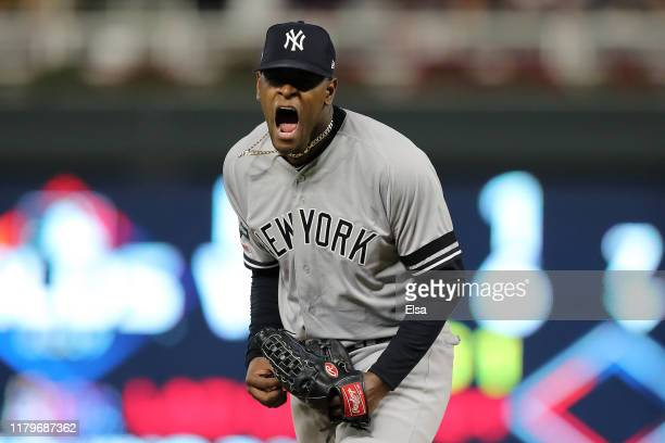 Luis Severino of the New York Yankees reacts after striking out Jake Cave of the Minnesota Twins with the bases loaded in the second inning of game...