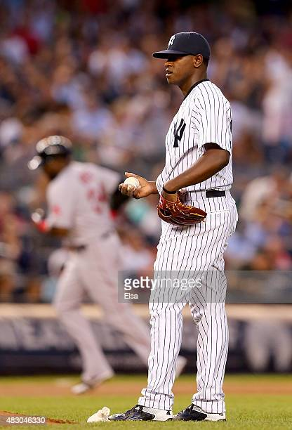 Luis Severino of the New York Yankees reacts as David Ortiz of the Boston Red Sox rounds third base after a solo home run in the fourth inning on...