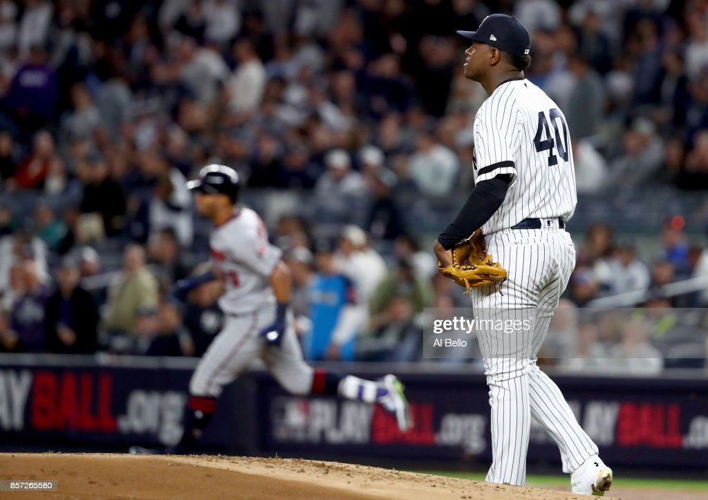Luis Severino #40 of the New York Yankees reacts as Eddie Rosario #20 of the Minnesota Twins rounds the bases after hitting a two run home run during the first inning in the American League Wild Card Game at Yankee Stadium on October 3, 2017 in the Bronx borough of New York City.