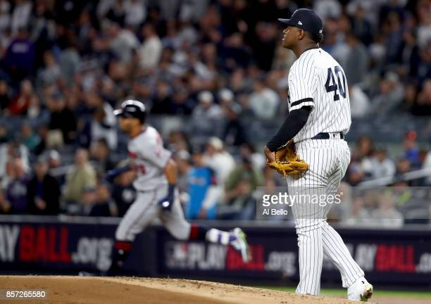 Luis Severino of the New York Yankees reacts as Eddie Rosario of the Minnesota Twins rounds the bases after hitting a two run home run during the...