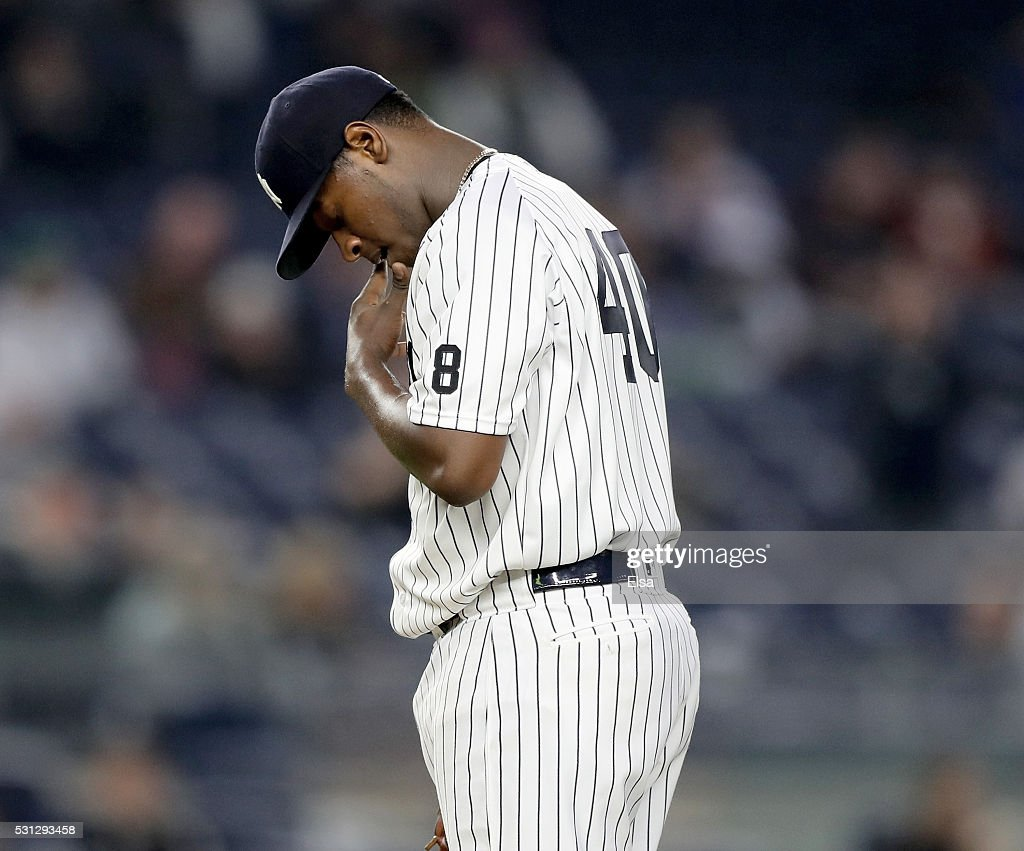 Luis Severino #40 of the New York Yankees reacts in the third inning against the Chicago White Sox at Yankee Stadium on May 13, 2016 in the Bronx borough of New York City.