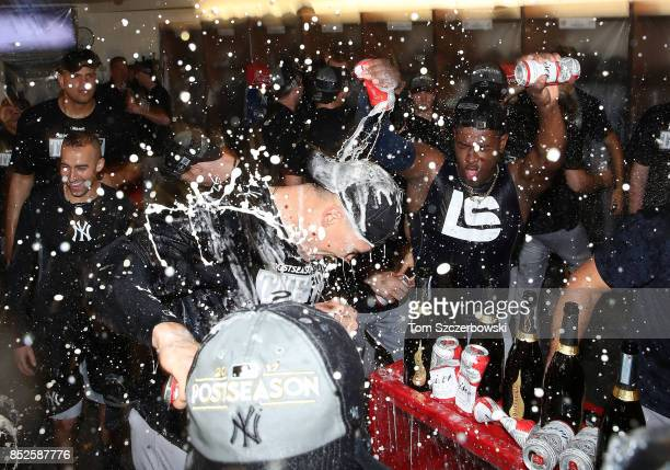Luis Severino of the New York Yankees sprays Aaron Judge as they celebrate their playoffclinching victory during MLB game action against the Toronto...