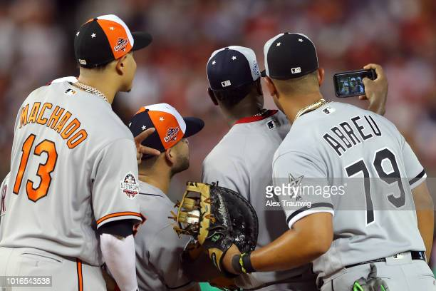 Luis Severino of the New York Yankees takes a selfie with teammate Manny Machado of the Baltimore Orioles Jose Altuve of the Houston Astros and Jose...