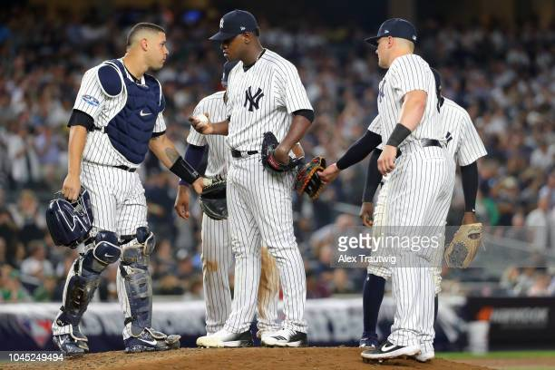 Luis Severino of the New York Yankees talks with catcher Gary Sanchez on the mound in the fifth inning during the American League Wild Card game...