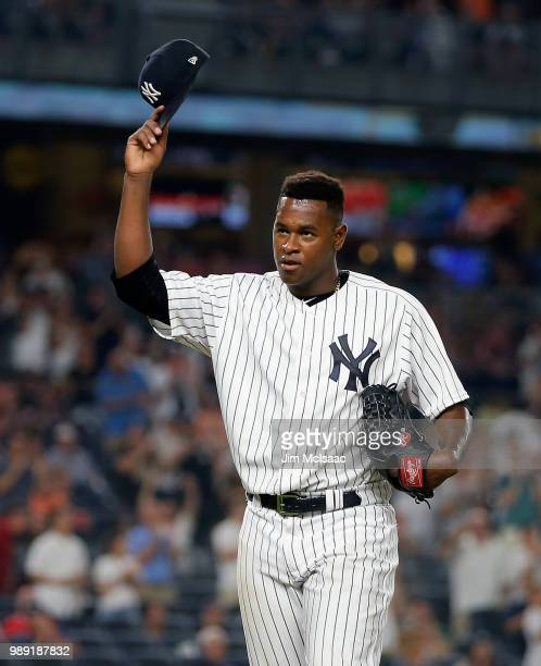 Luis Severino of the New York Yankees tips his cap to the crowd as he leaves a game against the Boston Red Sox in the seventh inning at Yankee...
