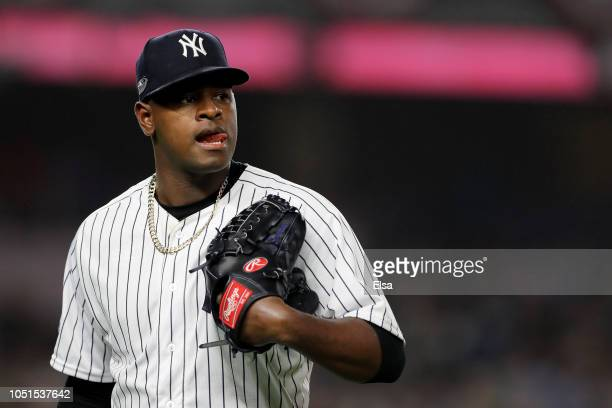 Luis Severino of the New York Yankees walks back to the dugout after being pulled against the Boston Red Sox during the fourth inning in Game Three...