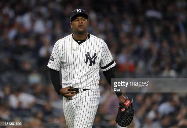 Luis Severino of the New York Yankees walks to the dugout after being pulled during the fifth inning against the Houston Astros in game three of the...