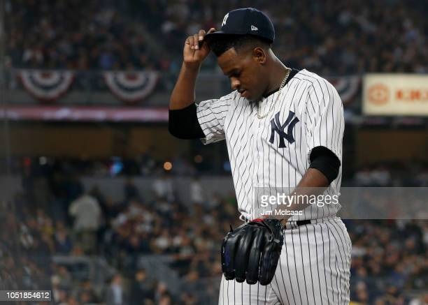 Luis Severino of the New York Yankees walks to the dugout as he leaves against the Boston Red Sox in Game Three of the American League Division...