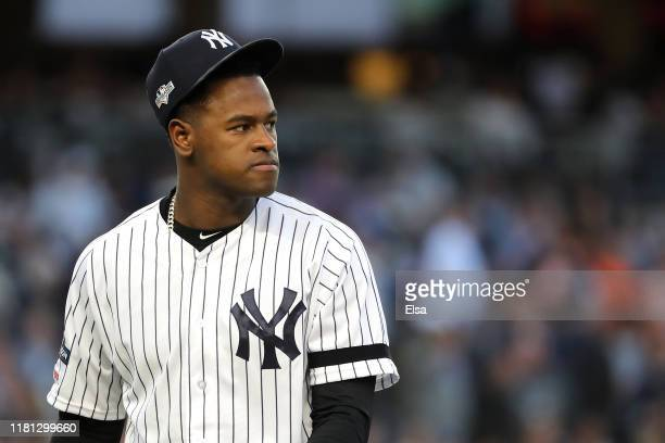 Luis Severino of the New York Yankees walks to the dugout prior to the fifth inning as the home plate umpire is replaced in game three of the...