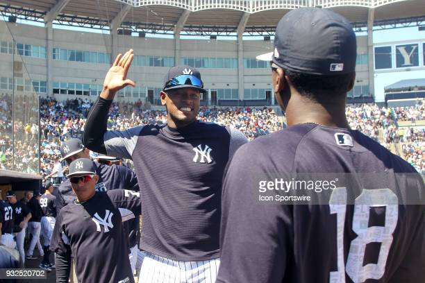 Luis Severino of the Yankees is all smiles as he prepares to high five Didi Gregorius before the game between the Pittsburgh Pirates and the New York...