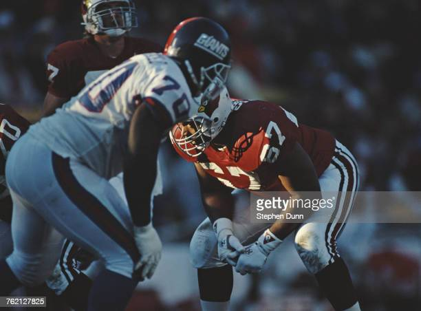 Luis Sharpe Tackle for the Arizona Cardinals keeps his eyes on Leonard Marshall of the New York Giants during their National Football Conference East...