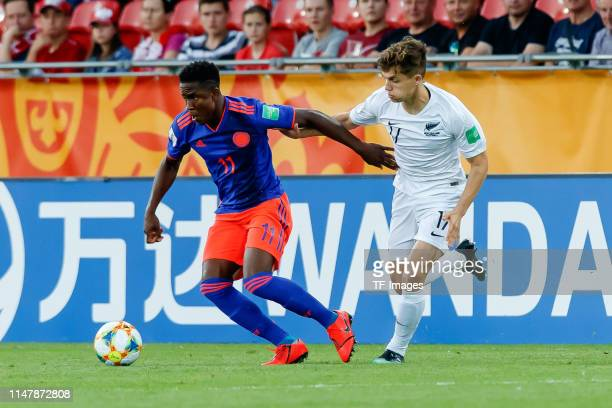 Luis Sinisterra of Colombia and Callan Elliot of New Zealand battle for the ball during the 2019 FIFA U20 World Cup Round of 16 match between...