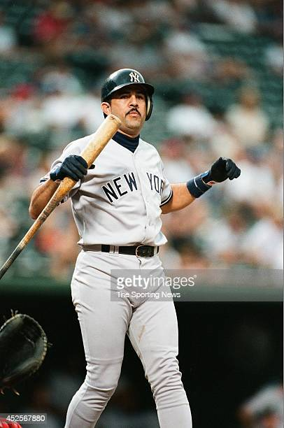 Luis Sojo of the New York Yankees looks on against the Texas Rangers at Rangers Ballpark on August 6 1997 in Arlington Texas The Rangers defeated the...