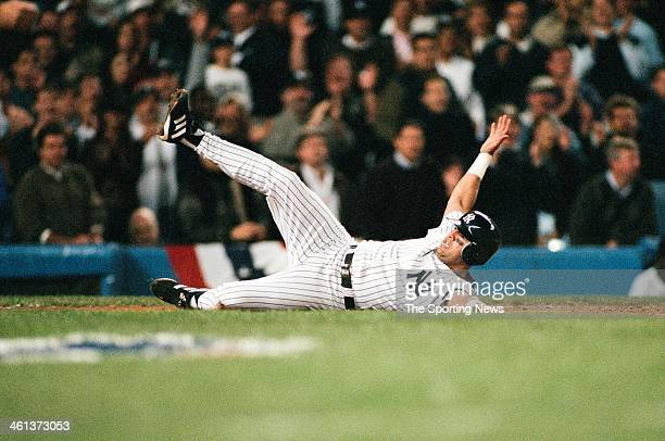 Luis Sojo of the New York Yankees slides during Game Two of the American League Championship Series against the Seattle Mariners on October 11 2000...