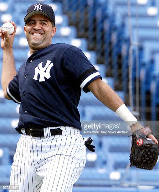 Luis Sojo warming up at Yankee Stadium is happy to be back in a New York Yankees' uniform after being reacquired from the Pittsburgh Pirates