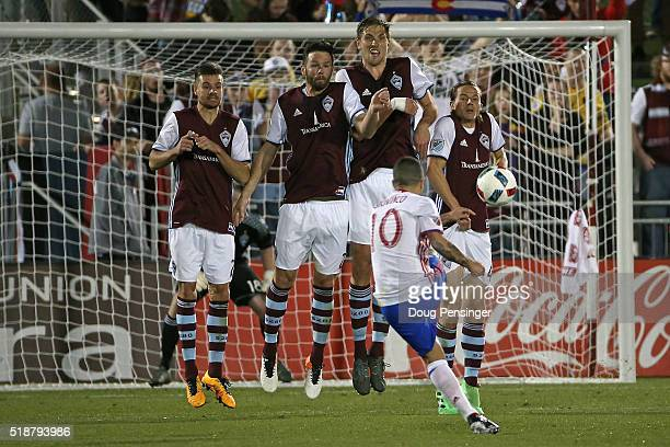 Luis Solignac Bobby Burling Axel Sjoberg and Marc Burch of Colorado Rapids defend against a free kick by Sebastian Giovinco of Toronto FC at Dick's...