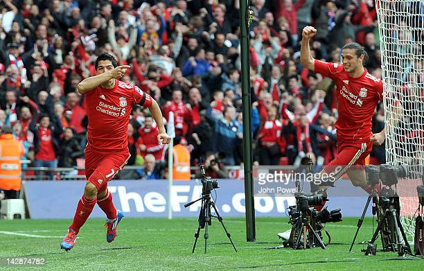 Luis Suarez and Andy Carroll of Liverpool celebrate The Luis Suarez goal during the FA Cup semifinal sponsored by Budweiser between Liverpool and...