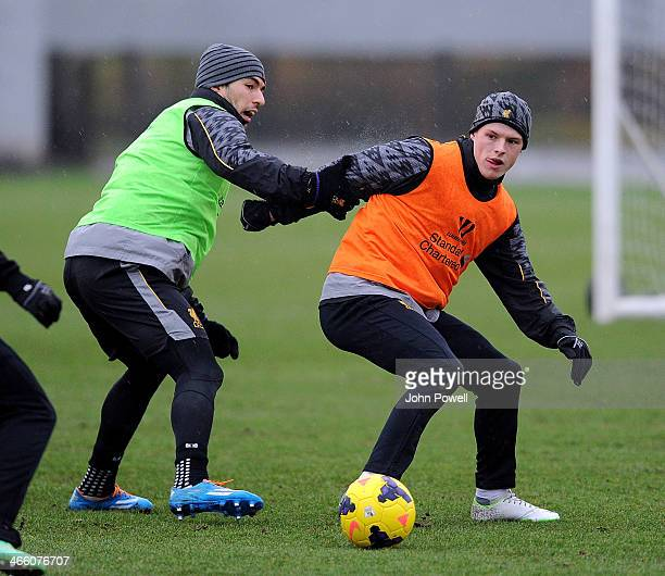 Luis Suarez and Brad Smith of Liverpool in action during a training session at Melwood Training Ground on January 31 2014 in Liverpool England