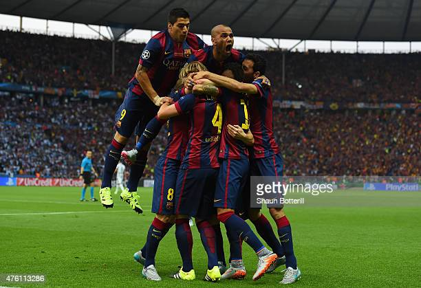 Luis Suarez and Daniel Alves of Barcelona celebrate with team mates after the goal scored by Ivan Rakitic during the UEFA Champions League Final...