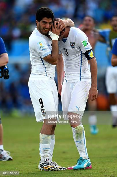 Luis Suarez and Diego Godin of Uruguay celebrate the 10 win after the 2014 FIFA World Cup Brazil Group D match between Italy and Uruguay at Estadio...