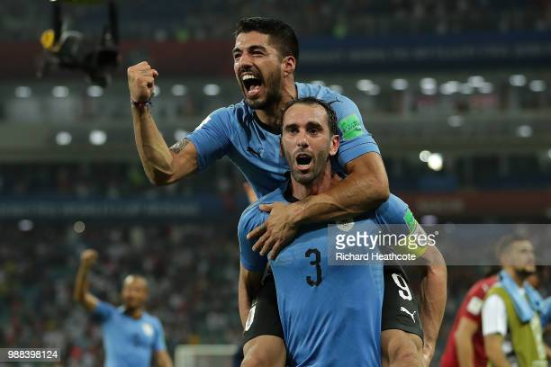 Luis Suarez and Diego Godin of Uruguay celebrate victory at the final whistle during the 2018 FIFA World Cup Russia Round of 16 match between Uruguay...