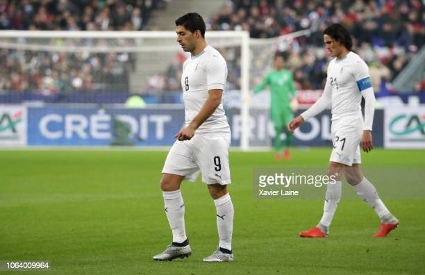 Luis Suarez and Edinson Cavani of Uruguay are disapointed during the International Friendly match between France and Uruguay at Stade de France on...