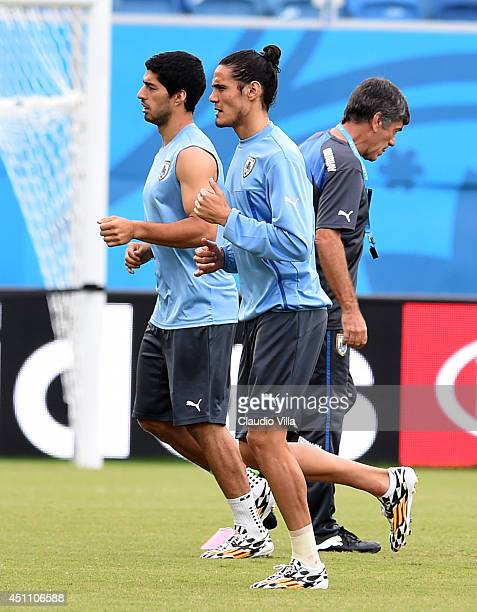 Luis Suarez and Edinson Cavani of Uruguay during a training session at the Dunas Arena in Natal on June 23 2014 in Natal Brazil