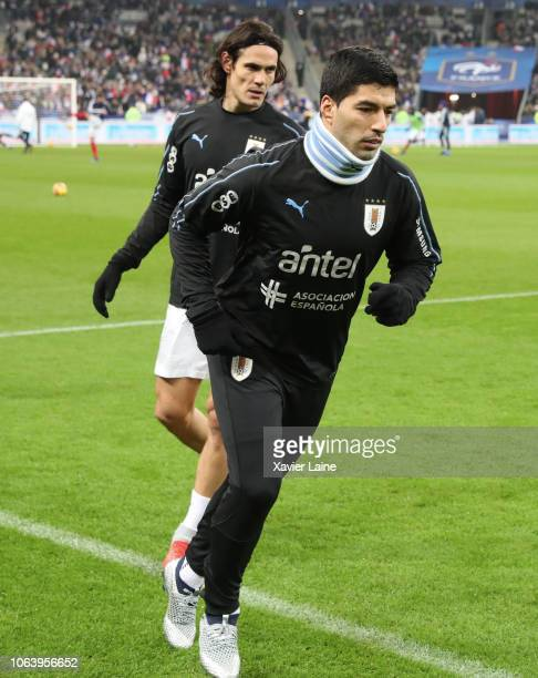 Luis Suarez and Edinson Cavani of Uruguay reacts before the International Friendly match between France and Uruguay at Stade de France on November 20...