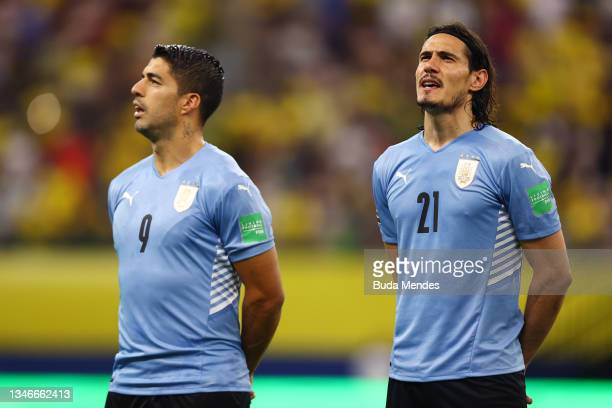 Luis Suarez and Edinson Cavani of Uruguay sing the national anthem prior to a match between Brazil and Uruguay as part of South American Qualifiers...