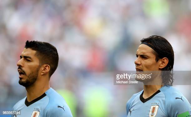 Luis Suarez and Edinson Cavani sing national atnhem prior to the 2018 FIFA World Cup Russia group A match between Uruguay and Russia at Samara Arena...