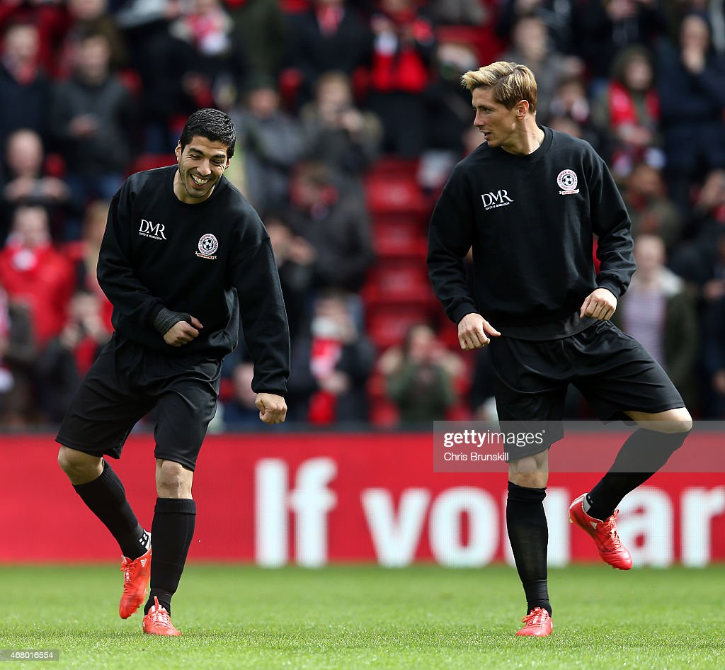 Luis Suarez and Fernando Torres of the Gerrard XI warm up ahead of the Liverpool All-Star Charity match at Anfield on March 29, 2015 in Liverpool, England.