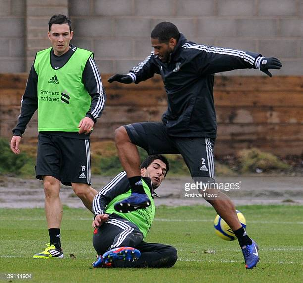 Luis Suarez and Glen Johnson of Liverpool in action during a training session at Melwood Trsining ground on February 17, 2012 in Liverpool, England.