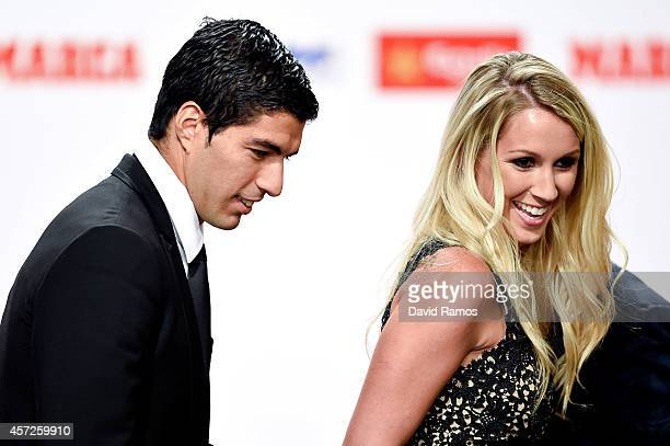 Luis Suarez and his wife Sofia Balbi arrive to the Golden Boot Awards Ceremony on October 15 2014 in Barcelona Spain Luis Suarez scored 31 goals for...