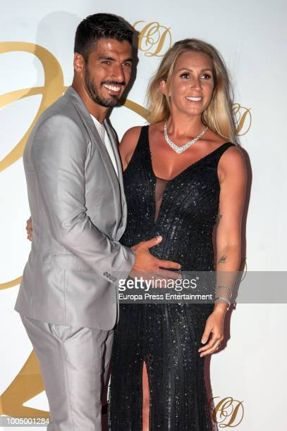 Luis Suarez and his wife Sofia Balbi attend Cesc Fabregas and Daniella Semaan's wedding party on July 24 2018 in Ibiza Spain