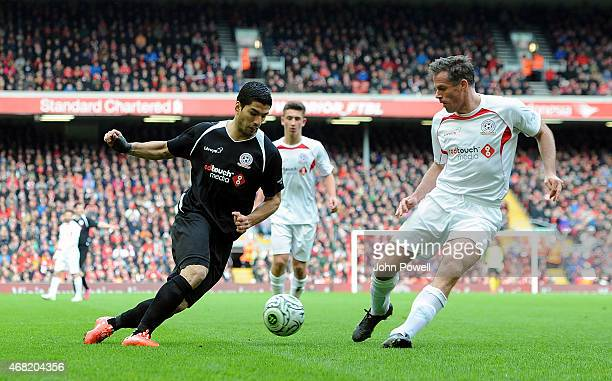Luis Suarez and Jamie Carragher during the Liverpool All Star Charity Match at Anfield on March 29 2015 in Liverpool England