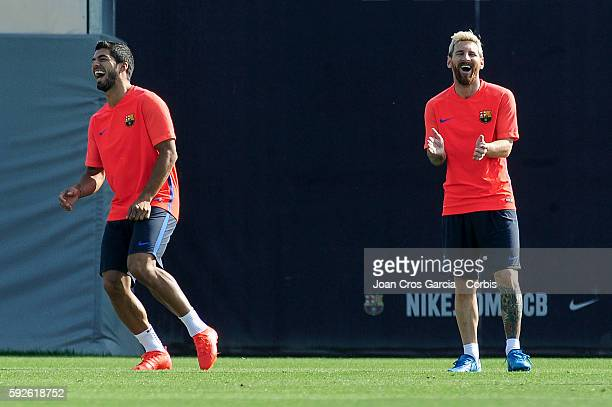 Luis Suarez and Lionel Messi attend a training session at the Sports Center FC Barcelona Joan Gamper before the first Spanish League match between...