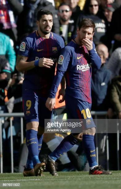 Luis Suarez and Lionel Messi of Barcelona celebrate after scoring a goal during the La Liga match between Real Madrid and Barcelona at Santiago...