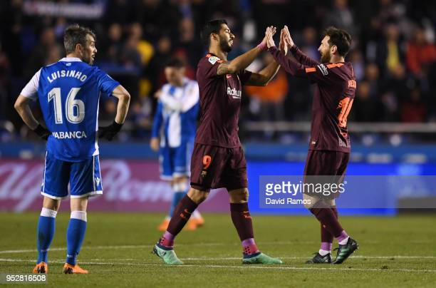 Luis Suarez and Lionel Messi of Barcelona celebrate winning the title after the La Liga match between Deportivo La Coruna and Barcelona at Estadio...