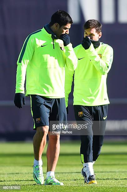 Luis Suarez and Lionel Messi of FC Barcelona chats during a training session ahead of their UEFA Champions League Group F match against Paris...