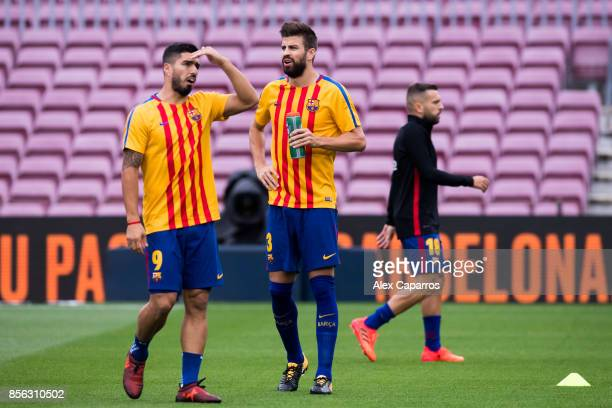 Luis Suarez and Lionel Messi of FC Barcelona look on before the La Liga match between Barcelona and Las Palmas at Camp Nou on October 1 2017 in...