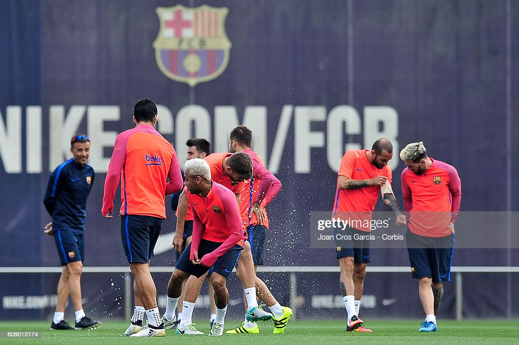 Luis Suarez and Neymar Jr., of FC Barcelona attend a training session at the Sports Center FC Barcelona Joan Gamper before the Spanish League match between FC Barcelona vs Club Atlético de Madrid, on September 20, 2016 in Barcelona, Spain.