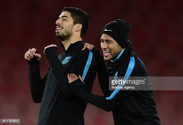 Luis Suarez and Neymar of FC Barcelona attend a training session prior to the Champions League round of 16 first leg soccer match between Arsenal and...