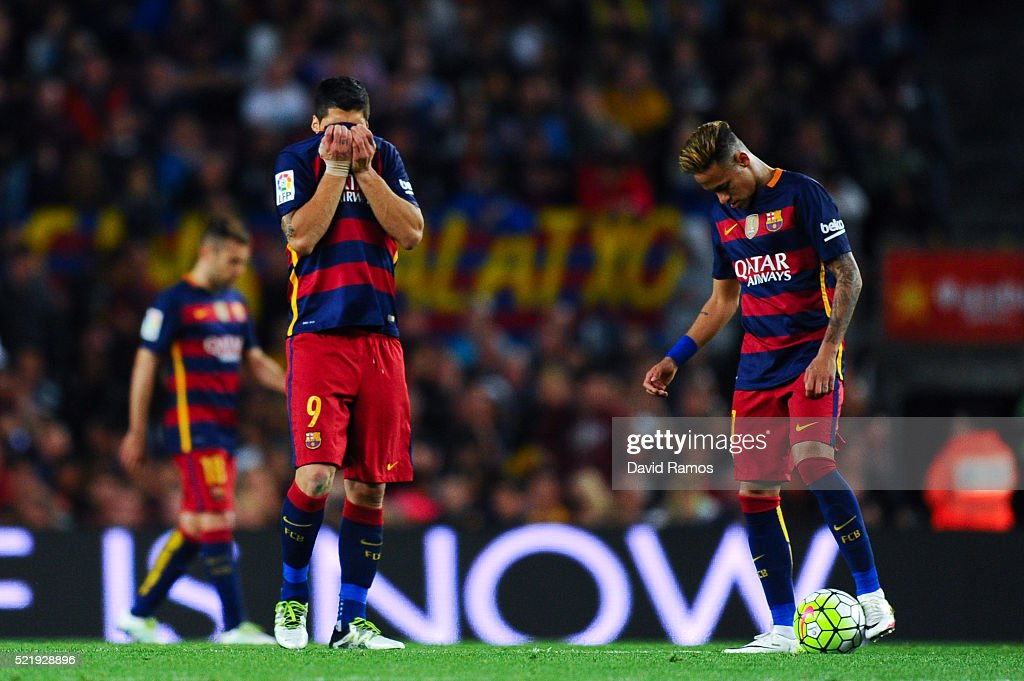 Luis Suarez (L) and Neymar of FC Barcelona look on dejected after Santi Mina of Valencia CF scored his team's second goal during the La Liga match between FC Barcelona and Valencia CF at Camp Nou on April 17, 2016 in Barcelona, Spain.