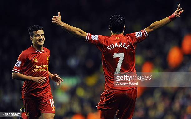 Luis Suarez and Philippe Coutinho of Liverpool celebrate the first goal during the Barclays Premier League match between Liverpool and Norwich City...
